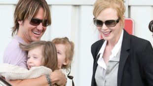 Nicole Kidman gets a welcome kiss from Keith Urban as she lands in Sydney.  Pictured: Nicole Kidman and keith Urban and sunday rose Ref: SPL487285  290113   Picture by: Grey Wasp/Blue Wasp/Splash News  Splash News and Pictures Los Angeles:	310-821-2666 New York:	212-619-2666 London:	870-934-2666 photodesk@splashnews.com