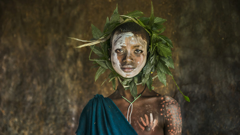 DSC_7397, Omo Valley, Ethiopia, 08/2013, ETHIOPIA-10319. Child with wreath of leaves around head. retouched_Sonny Fabbri 09/04/2013